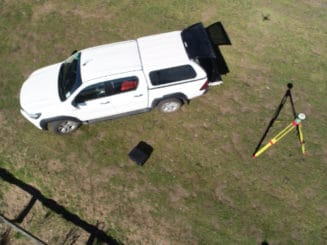 photo of a surveyor's work vehicle, taken from the aerial drone