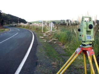 Total station set up by road side for surveying work